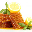 Sweet honeycombs with lemon and mint, isolated on white — Stock Photo #12712083