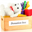 Donation box with children toys isolated on white — Stock Photo