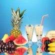Milk shakes with fruit on blue background close-up — Stock Photo #12712308