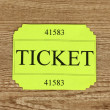 Colorful ticket on wooden background close-up — Lizenzfreies Foto