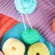Stock Photo: Colorful wool sweaters and balls of wool close-up