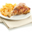 Roast chicken with french fries on plate, isolated on white — Stock Photo #12713237
