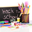 The words 'Back to School' written in chalk on the small school desk with v — Stok fotoğraf