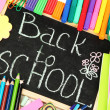 The words 'Back to School' written in chalk on the small school desk with v — Stock Photo