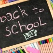 The words 'Back to School' written in chalk on the small school desk with v - Foto de Stock