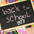 The words 'Back to School' written in chalk on the small school desk with v — Stock Photo #12713423