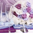 Serving fabulous wedding table in purple color on white fabric background - Stock Photo