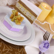 Serving fabulous wedding table in purple and gold color close-up - Stock Photo