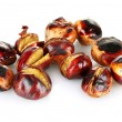 Some roasted chestnuts isolated on white — Stock Photo