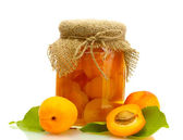Canned apricots in a jar and sweet apricots isolated on white — Stock Photo