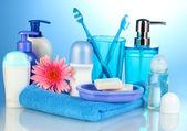 Bathroom setting on blue background — Stock Photo