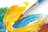 Abstract gouache paint and brush, isolated on white — Stock Photo