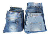 Två staplar mode blå jeans isolerad på vit — Stockfoto