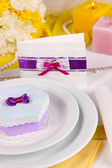 Purple gift for guests on wedding table close-up — Stock Photo