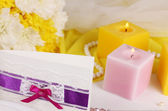 Purple invitation on wedding table close-up — Stock Photo