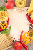 Paper for recipes, spaghetti with vegetables and spices, on sacking background — Стоковое фото