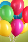 Colorful balloons on green background — Stock Photo