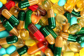 Colorful capsules and pills, close up — Stock Photo