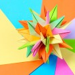 Colorfull origami kusudama on bright paper background — Stock Photo