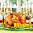 Stock Photo: banquet table with roast chicken and glasses of wine. Thanksgiving Day