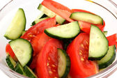 Fresh salad with tomatoes and cucumbers close-up — Stock Photo