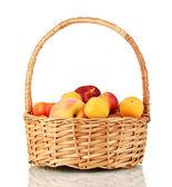 Ripe fruit in basket isolated on white — Stock Photo