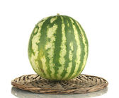 Ripe watermelon on wicker mat isolated on white — Stock Photo