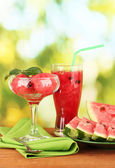 Refreshing desserts of watermelon on green background close-up — Stock Photo