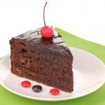 Chocolate sacher cake close-up isolated on white — Stock Photo