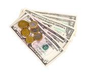Dollarsedlar och mynt isolerad på vit — Stockfoto