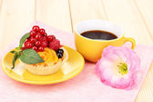 Dulcet cake with fruit and berries on wooden table — Stock Photo