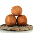 Coconuts on wicker mat isolated on white — Stock Photo