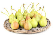 Ripe pears on wicker mat isolated on white — Stock Photo