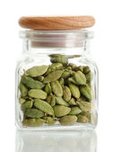 Jar of cardamom isolated on white close-up — Stock Photo