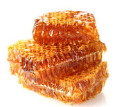 Sweet honeycombs with honey, isolated on white — Stock Photo