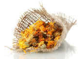 Dried calendula flowers in sacking, isolated on white — Stock Photo