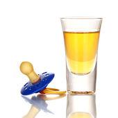 Baby dummy with alcoholic beverage isolated on white — Stock Photo