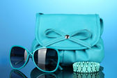 Women's fashion accessories on bright colorful background — Stock Photo