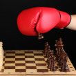 Playing chess in boxing gloves isolated on black — Stock Photo #12778559