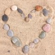 Love-stones on sand — Stockfoto