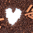 Pattern of heart on coffee beans background. Frame. — Stock Photo