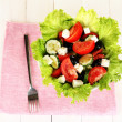 Tasty Greek salad on white wooden background - Stock Photo