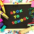 Stock Photo: Small chalkboard with school supplies on white background. Back to School