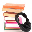 Headphones on books isolated on white - Zdjęcie stockowe