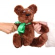 Santa Claus hand holding toy bear isolated on white — Stock Photo #12793406
