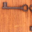 Two antique keys on wooden background — Stock Photo #12797006