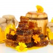Sweet honeycombs, barrel and jars with honey, isolated on white — Stock Photo #12797215