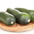Stock Photo: Fresh zucchini on wicker mat isolated on white
