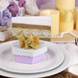Serving fabulous wedding table in purple and gold color on white and purple - Stock Photo
