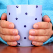 Hands holding mug of hot drink close-up — Stock Photo #12797909